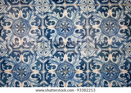 Traditional tiles (azulejos) on facade of old hosue in Lisbon, Portugal - stock photo