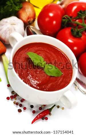 Traditional tomato soup and ingredients - stock photo