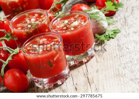 Traditional tomato soup gazpacho in a glass, selective focus - stock photo