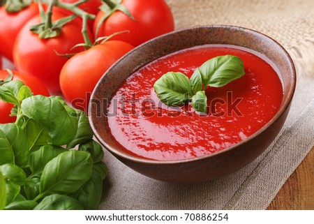 Traditional tomato soup with basil - stock photo