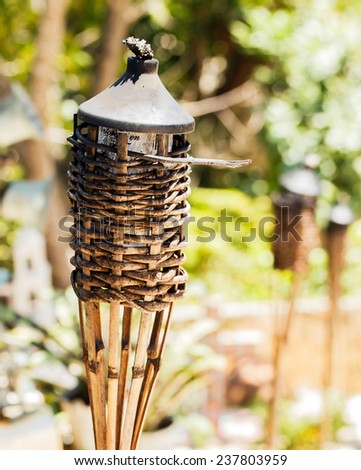 Traditional torches on colorful Mexican graveyard near Playa del Carmen - stock photo