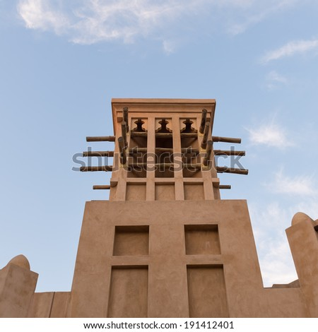Traditional tower inside the Souk of Madinat Jumeirah. Madinat Jumeirah encompasses two hotels and clusters of 29 traditional Arabic houses. - stock photo