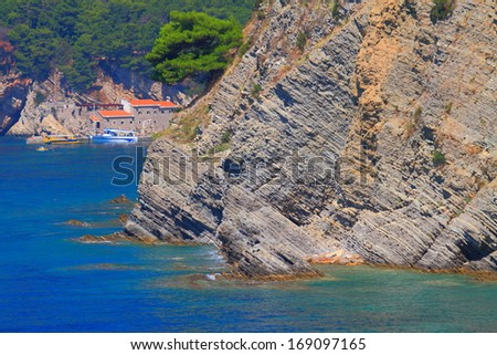 Traditional town and harbor on the shores of Adriatic sea - stock photo