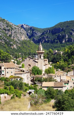 Traditional town Valldemossa in Majorca, Spain. View of traditional houses and mountains in the summer.