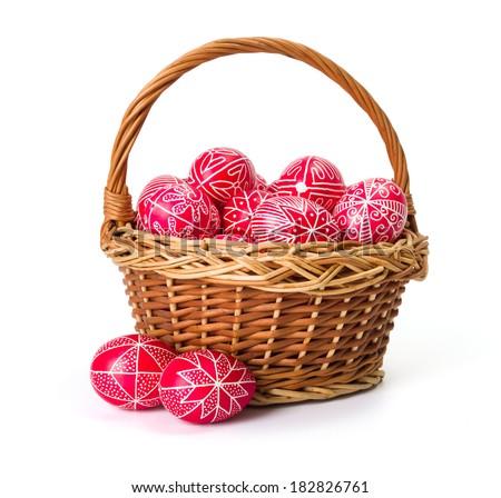 Traditional transylvanian hand written eggs in wicker basket - stock photo