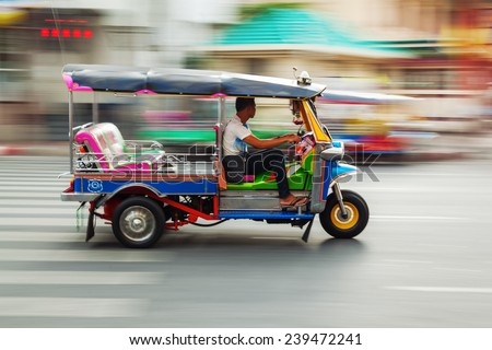 traditional tuk-tuk from Bangkok, Thailand, in motion blur - stock photo