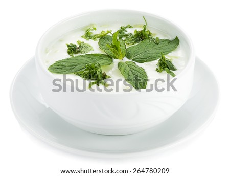 Traditional Turkish appetizer diced cucumber, garlic and mint in yoghurt, called cacik isolated on white background. - stock photo