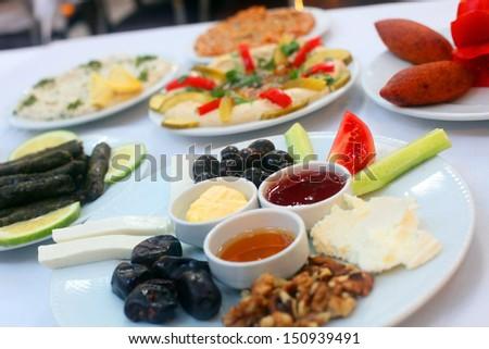 Traditional Turkish breakfast at restaurant table in Antakya, Turkey. - stock photo