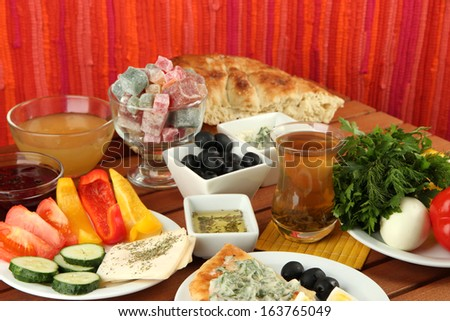 Traditional Turkish breakfast on table on fabric background
