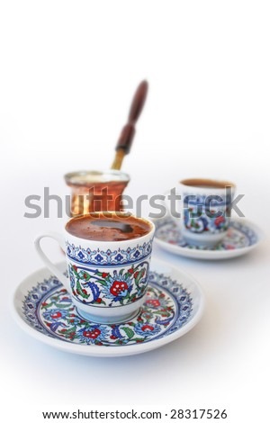 Traditional Turkish Coffee. Mocha with a cezve. Isolated on white.