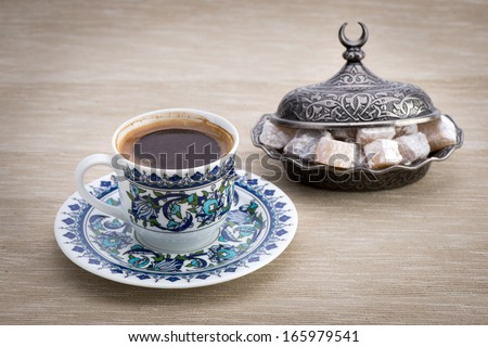 Traditional Turkish coffee served with Turkish delight - stock photo