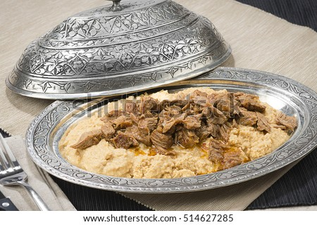 Traditional Turkish food called Hunkar Begendi, lamb stew served on mashed eggplant.