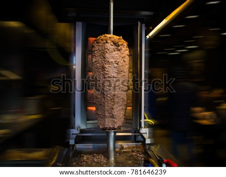traditional turkish food doner kebab in a street food shop on blur background