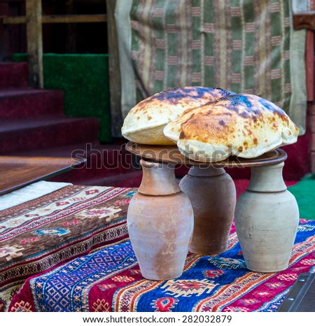 Traditional turkish kebab dish in an earthenware jar on the restaurant table in Istanbul. Testi Kebab with lavash - a hot dish of lamb, cooked on an open fire with fresh tortillas. - stock photo