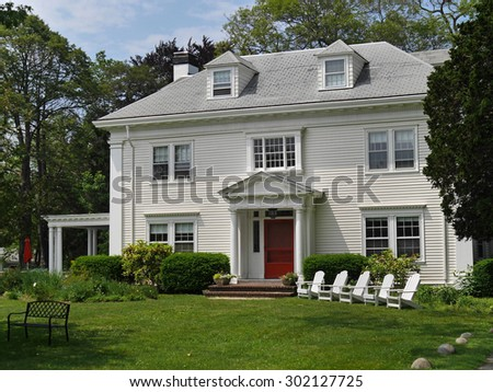Traditional two storey house with white siding