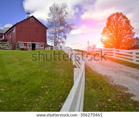 Traditional typical looking American building with white fence  - stock photo