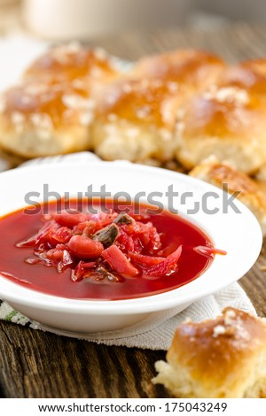 Traditional Ukrainian beetroot soup - red borsch and dumplings with garlic - stock photo