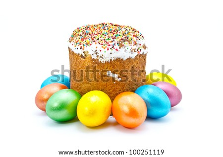 Traditional Ukrainian Easter cake with painted eggs, isolated on a white background - stock photo