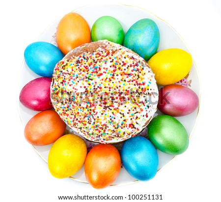 Traditional Ukrainian Easter cake with painted eggs on a plate, isolated on a white background - stock photo