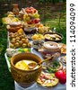 Traditional ukrainian food in assortment in festive decorating on the table - stock photo