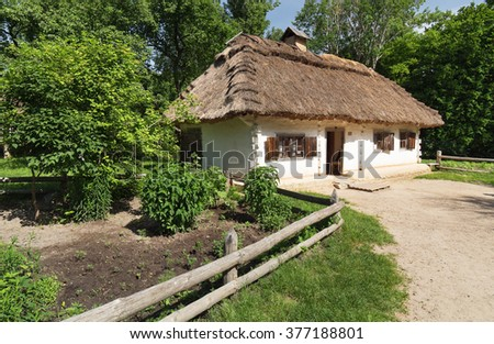 Traditional Ukrainian house with thatch,Ukraine - stock photo
