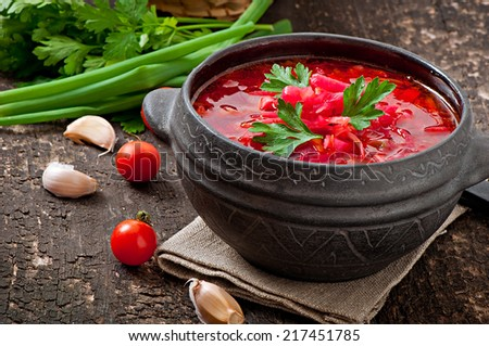 Traditional Ukrainian Russian vegetable borsch on the old wooden background - stock photo