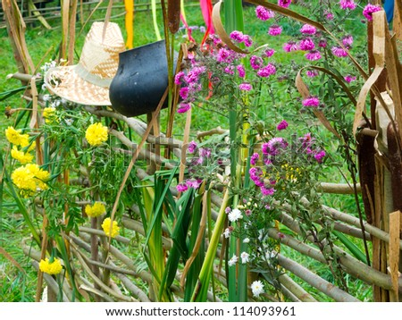 Traditional Ukrainian wattle with flowers, old hat and pot - stock photo