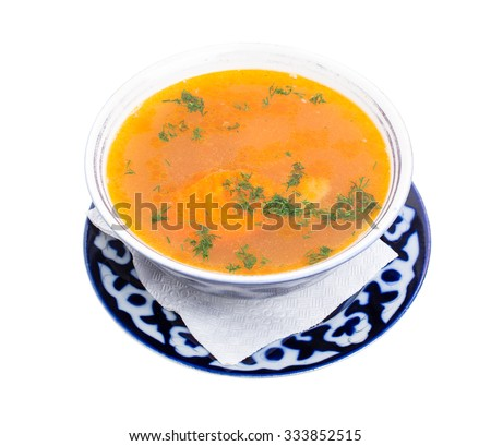 Traditional uzbek dumpling soup with sour cream. Served on athentic oriental bowl. Isolated on a white background. - stock photo