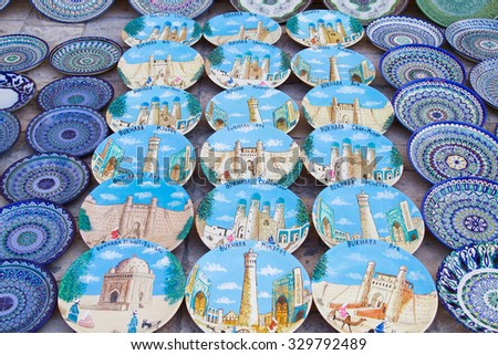 Traditional Uzbek Plates and dishes in Uzbekistan, Central Asia. Silk Road country.Plates with traditional uzbekistan ornament. There are commonly sold in tourist places like Bukhara, Khiva, Samarkand - stock photo