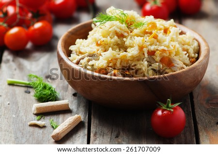 Traditional uzbek pliaw with carrot and onion, selective focus - stock photo