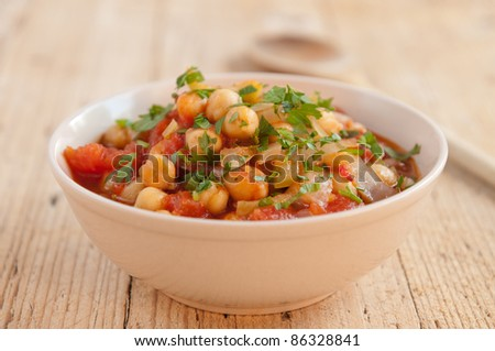 Traditional vegetarian meal with chick peas and vegetables - stock photo