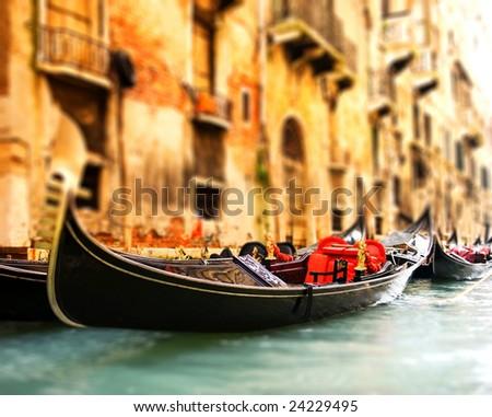 Traditional Venice gandola ride (shallow DoF, focus on gandola) - stock photo