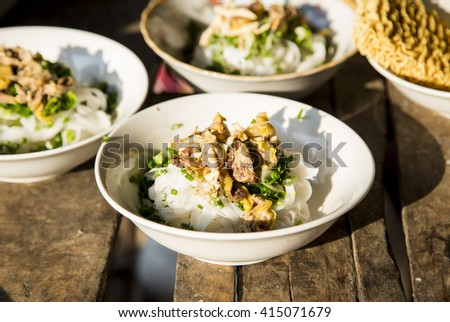 Traditional Vietnamese chicken soup (Pho ga) on a wooden background