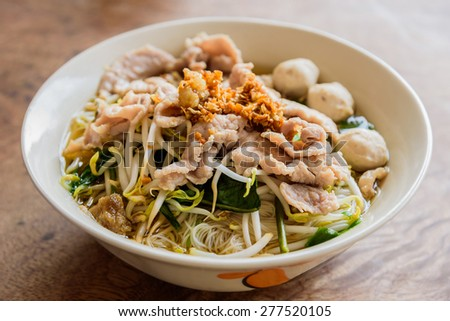 Traditional Vietnamese pork soup pho on a wooden background  - stock photo