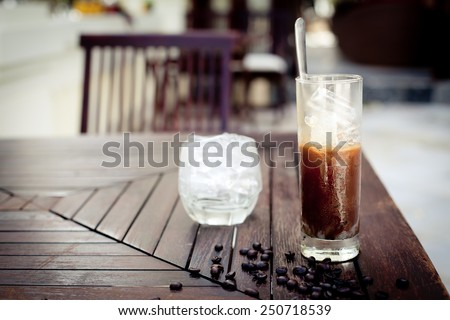 Traditional Vietnamese, Thai Ice coffee with coffee beans on a wooden background - stock photo