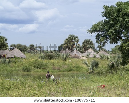 traditional village along nile river in south sudan - stock photo