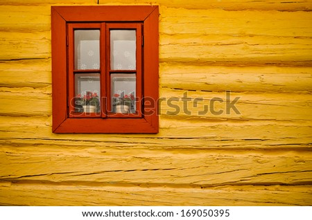 Traditional village house wall and window in vivid colors. - stock photo