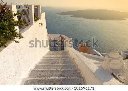 Traditional village of Oia at Santorini island in Greece during sunset. - stock photo
