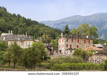 Traditional village of Papigo at Zagorohoria, Epiros, Pindos mountains in Greece - stock photo