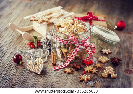 Traditional vintage christmas cookies with icing, festive table decoration - stock photo