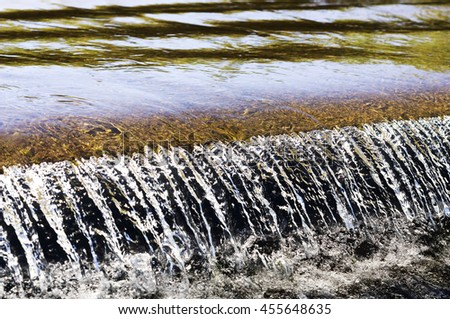 traditional water canals to irrigate crops  in the Castilla fields, Spain - stock photo