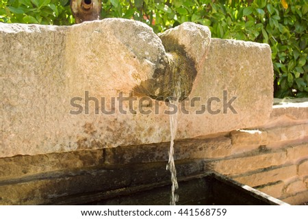 traditional water fountain as one of important element in japanese garden landscape  - stock photo