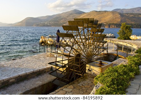 Traditional water mill at the sinkholes on Lassi area of Kefalonia island in Greece - stock photo