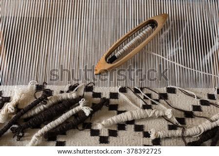 Traditional weaving hand-loom for carpets in Transylvania. Hungarian homespun weaving. - stock photo