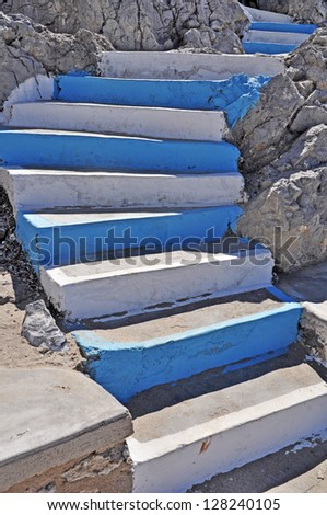traditional white and blue stairs in a Greek island - stock photo