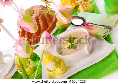 traditional white borscht and ring cake on  easter table