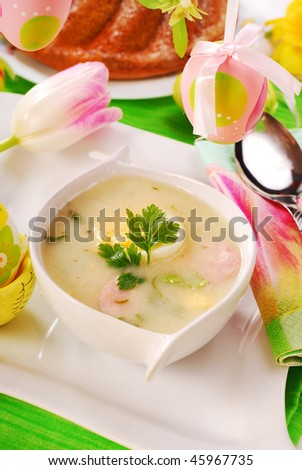traditional white borscht  on easter table