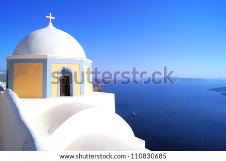Traditional white church overlooking the blue sea, Santorini, Greece