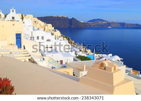 Traditional white village above sea on the island of Santorini, Greece