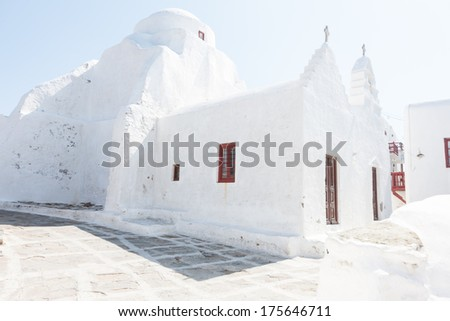 Traditional white-washed Greek houses on the island of Mikonos symbolic of a tropical summer vacation - stock photo